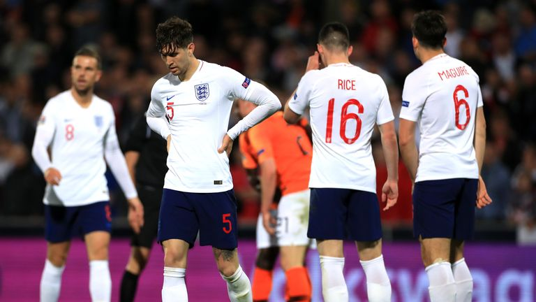 John Stones looks dejected after his error in extra-time