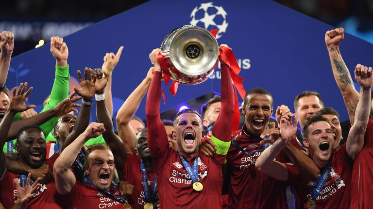 Jordan Henderson lifts the Champions League trophy