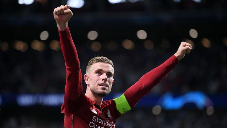 Jordan Henderson of Liverpool celebrates victory after the UEFA Champions League Final between Tottenham Hotspur and Liverpool at Estadio Wanda Metropolitano on June 01, 2019 in Madrid, Spain.