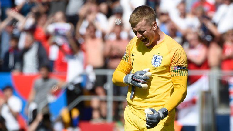 Jordan Pickford celebrates scoring a penalty in England's win over Switzerland