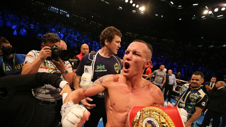 Josh Warrington celebrates in front of his hometown fans in Leeds