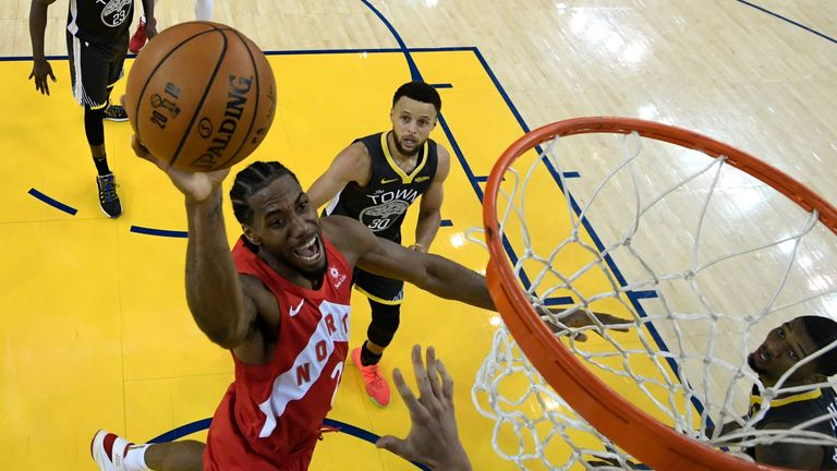 Kawhi Leonard #2 of the Toronto Raptors attempts a shot against the Golden State Warriors during Game Six of the 2019 NBA Finals at ORACLE Arena on June 13, 2019 in Oakland, California.