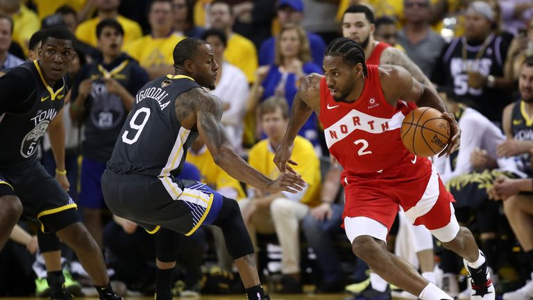 Kawhi Leonard #2 of the Toronto Raptors is defended by Andre Iguodala #9 of the Golden State Warriors in the first half during Game Four of the 2019 NBA Finals at ORACLE Arena on June 07, 2019 in Oakland, California.