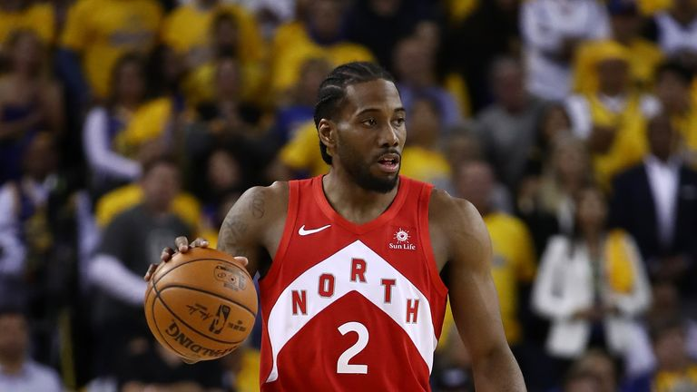 Kawhi Leonard #2 of the Toronto Raptors handles the ball on offense against the Golden State Warriors in the second half during Game Four of the 2019 NBA Finals at ORACLE Arena on June 07, 2019 in Oakland, California.