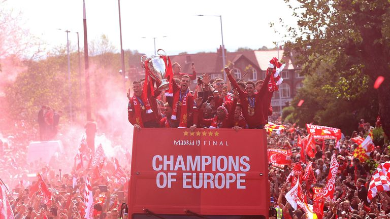 Liverpool's players enjoyed a triumphant return to Merseyside after winning the Champions League