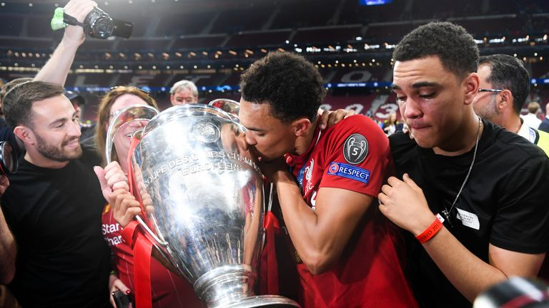 MADRID, SPAIN - JUNE 01: Trent Alexander-Arnold of Liverpool celebrates with the European Cup and members of his family during the UEFA Champions League Final between Tottenham Hotspur and Liverpool at Estadio Wanda Metropolitano on June 01, 2019 in Madrid, Spain. (Photo by Michael Regan/Getty Images)