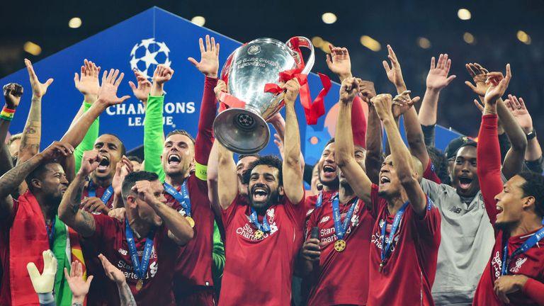 Mohamed Salah holds the Champions League trophy aloft