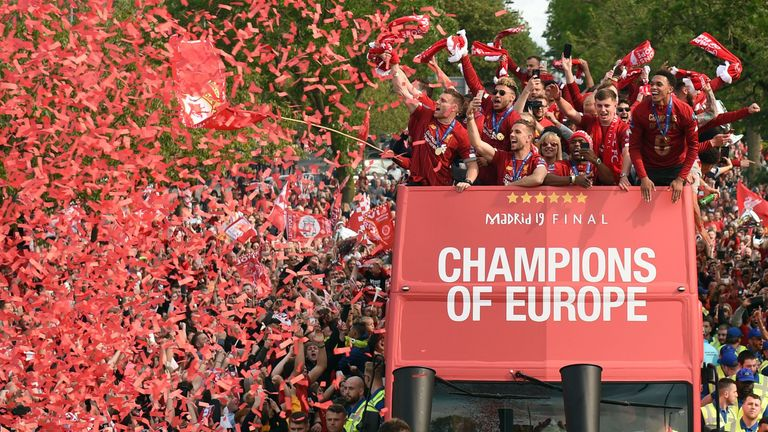 L to R James Milner, Alex Oxlade-Chamberlain, Jordan Henderson, Daniel Sturridge and Trent Alexander-Arnold cheer their fans during an open-top bus parade around Liverpool, north-west England on June 2, 2019, after winning the UEFA Champions League final football match between Liverpool and Tottenham. - Liverpool's celebrations stretched long into