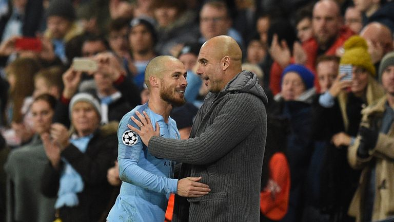 Pep Guardiola and David Silva on the touchline