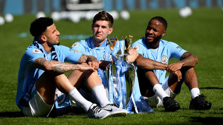 MANCHESTER, ENGLAND - MAY 06: Kyle Walker of Manchester City , John Stones of Manchester City and Raheem Sterling of Manchester City celebrates with The Premier League Trophy after the Premier League match between Manchester City and Huddersfield Town at Etihad Stadium on May 6, 2018 in Manchester, England. (Photo by Shaun Botterill/Getty Images)