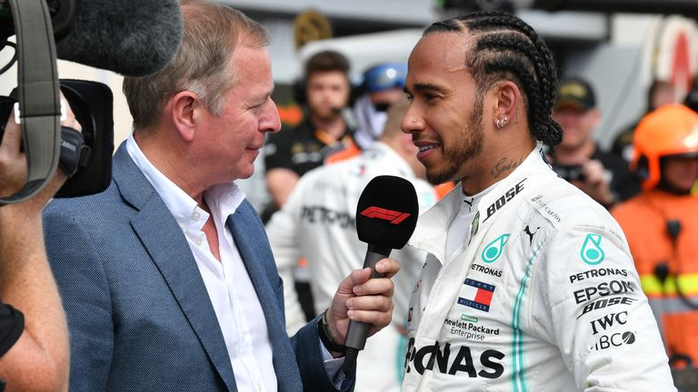 Martin interviews Lewis Hamilton after the Mercedes driver's victory in last year's French GP