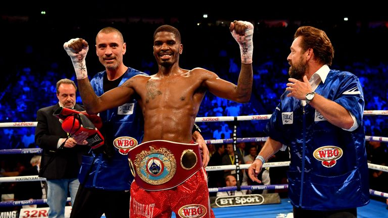 Maurice Hooker celebrates winning the WBO title at the Manchester Arena