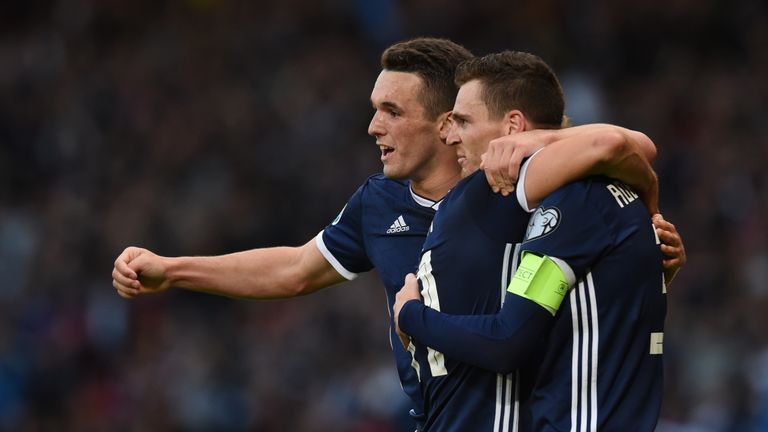 Scotland's John McGinn celebrates with Andy Robertson