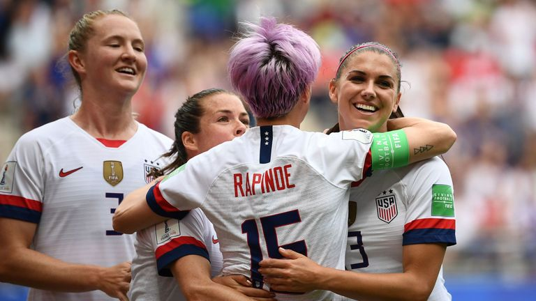 Rapinoe celebrates with team-mates after her first penalty in the seventh minute