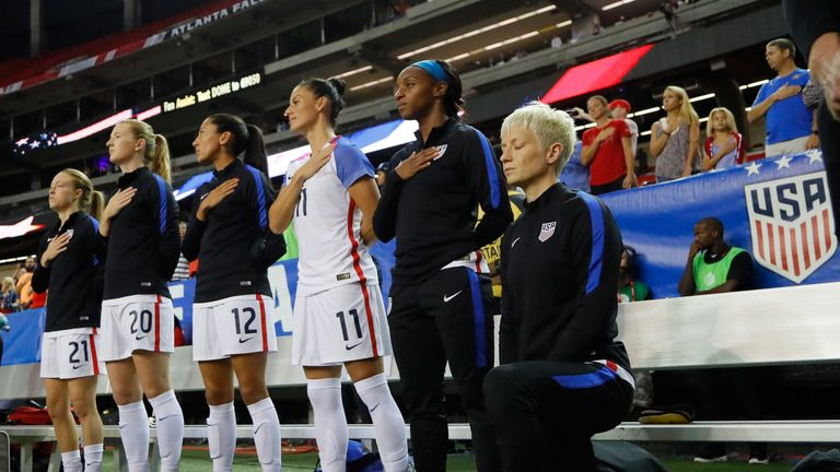 Megan Rapinoe kneels during the US national anthem in 2016