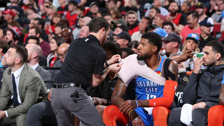 Paul George #13 of the Oklahoma City Thunder gets his shoulder wrap against the Portland Trail Blazers during Game One of Round One of the 2019 NBA Playoffs on April 14, 2019