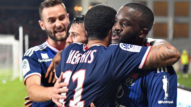 Tanguy Ndombele celebrates a goal for Lyon