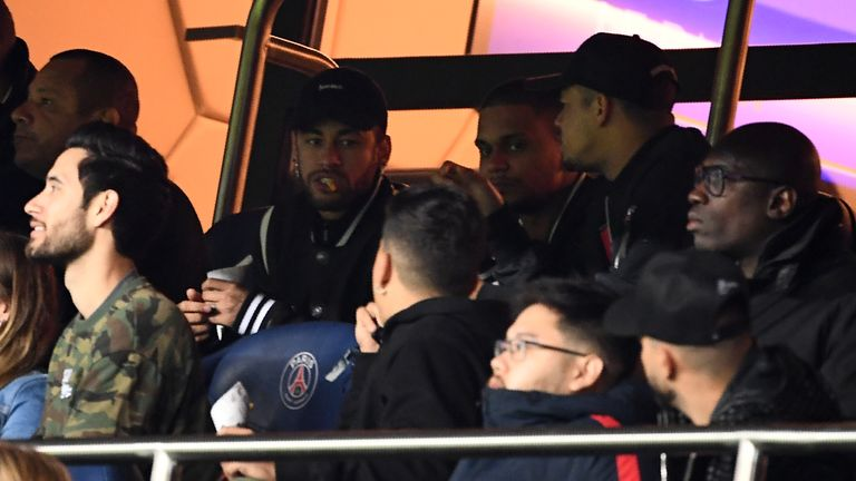 Neymar watches on during PSG's round of 16 game against Manchester United in March