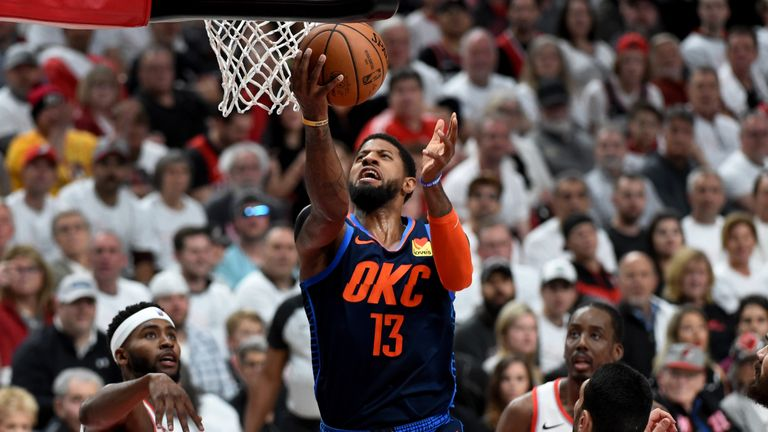 Paul George #13 of the Oklahoma City Thunder drives to the basket p