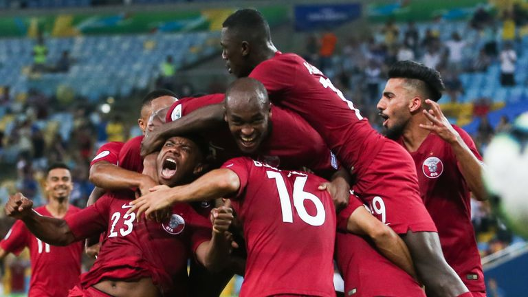Qatar's players celebrate their draw with Paraguay