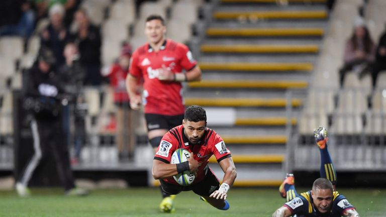 Richie Mo'unga scored two tries for the Crusaders as they overcame the Highlanders in Friday's quarter-final