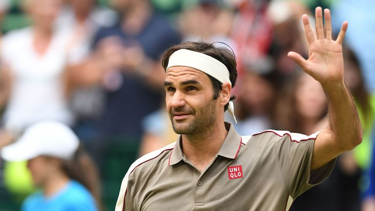 Switzerland's Roger Federer celebrates after winning against France's Jo-Wilfried Tsonga during their tennis match at the ATP Open tennis tournament in Halle, western Germany, on June 20, 2019.