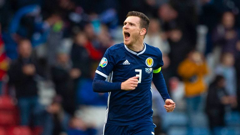 Scotland's Andy Robertson celebrates after he makes it 1-0