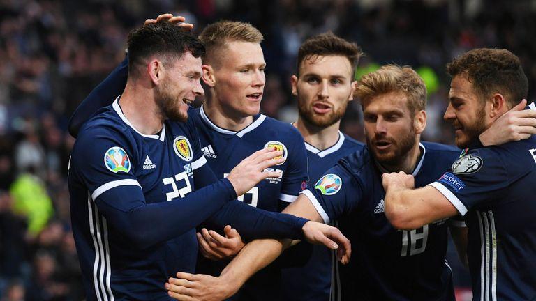 Scotland's Oliver Burke celebrates his late goal with team-mates