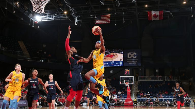 Diamond DeShields of the Chicago Sky drives to the basket for layup against the Washington Mystics