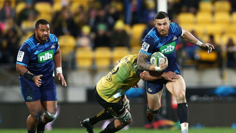 Sonny Bill Williams is tackled by the Hurricanes' Asafo Aumua during round 18