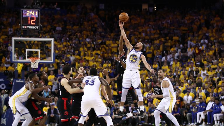 Stephen Curry of the Golden State Warriors goes up for a jump ball against the Toronto Raptors in the second half during Game 3 of the 2019 NBA Finals