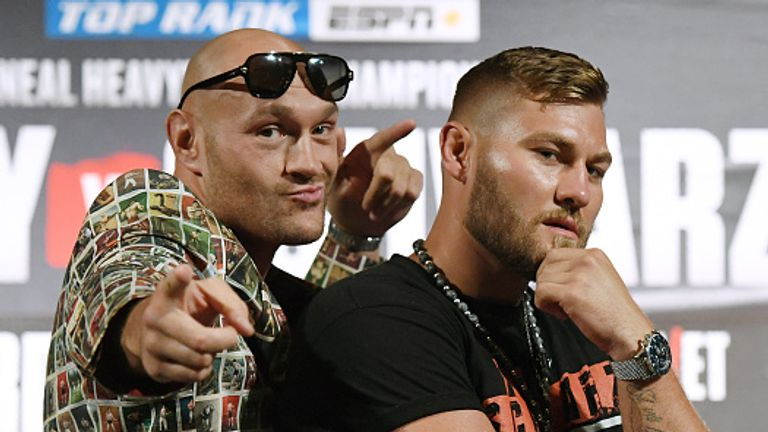 Fury poses before fighting Tom Schwarz