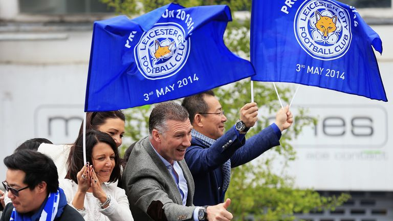 Leicester City manager Nigel Pearson and owner Vichai Srivaddhanaprabha ride in an open top bus through the city centre during a victory parade in honour of the football club winning the SkyBet Championship League trophy on May 5, 2014 in Leicester, England.