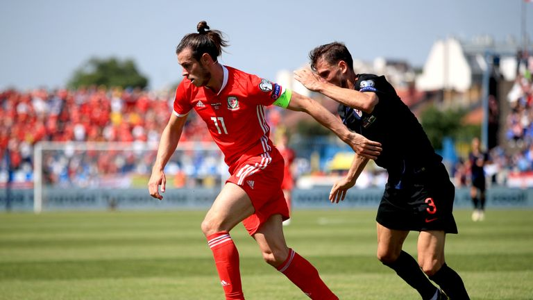Wales' Gareth Bale (left) and Croatia's Borna Barisic battle for the ball
