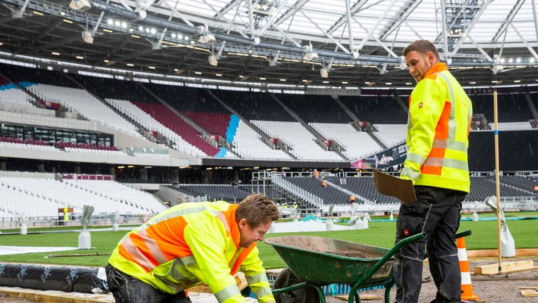 More than 141,900 square feet of artificial turf has been installed on top of the grass surface at the London Stadium