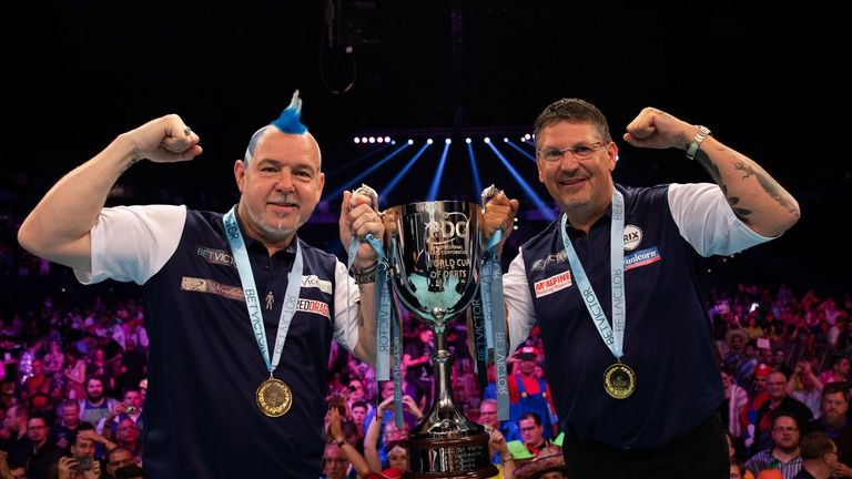 Peter Wright and Gary Anderson celebrate winning a first World Cup of Darts title