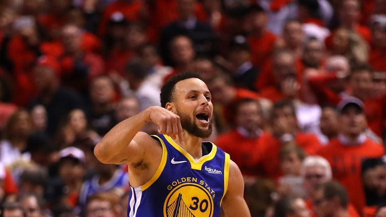 Stephen Curry celebrates a late three-pointer during the Warriors' Game 5 win