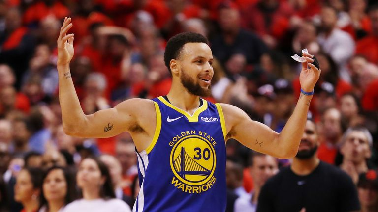 Stephen Curry celebrates the Golden State Warriors' narrow victory in Game 5 of the NBA Finals.