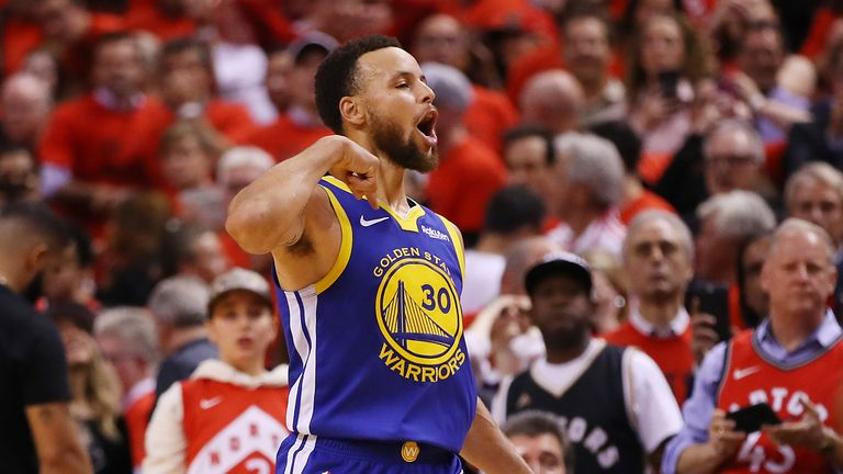 Stephen Curry celebrates after the Warriors win over the Raptors in Game 5 of the NBA Finals