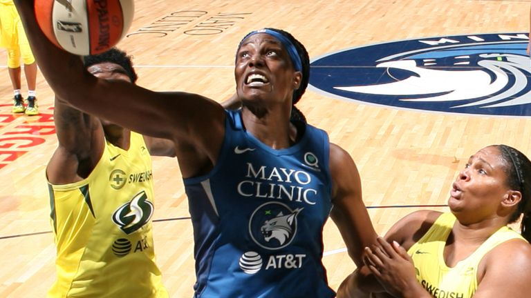 Sylvia Fowles attacks the basket for the Minnesota Lynx against the Seattle Storm