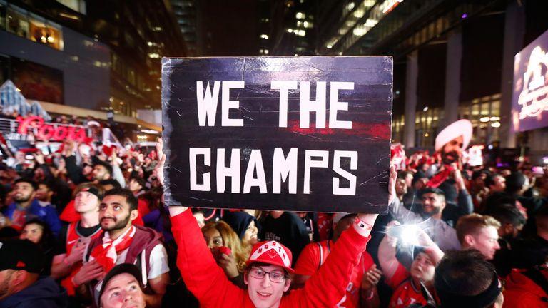 Toronto Raptors fans celebrate their team's maiden NBA title win in Jurassic Park