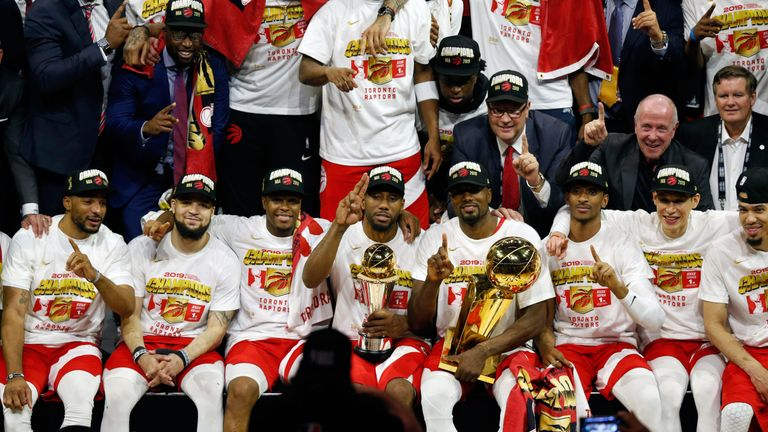 The Toronto Raptors celebrate after beating the Golden State Warriors to win their first NBA championship