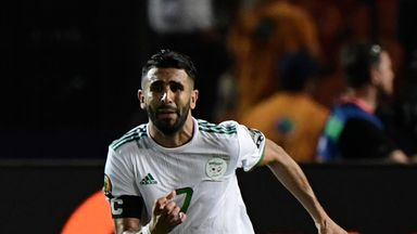 Riyad Mahrez scored a late free-kick against Nigeria in Cairo to send Algeria to the final