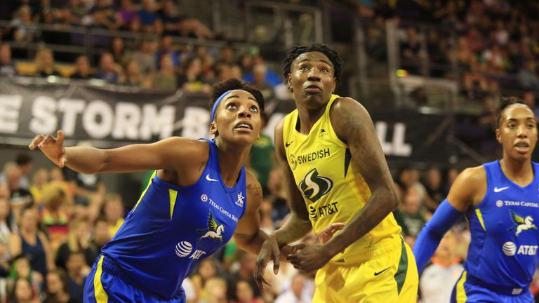 Glory Johnson and Natasha Howard contest a rebound