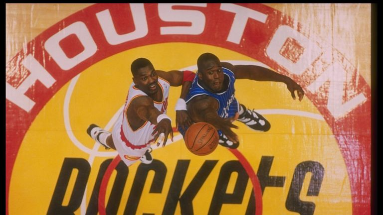 Hakeem Olajuwon and Shaquille O'Neal compete for a jump-ball