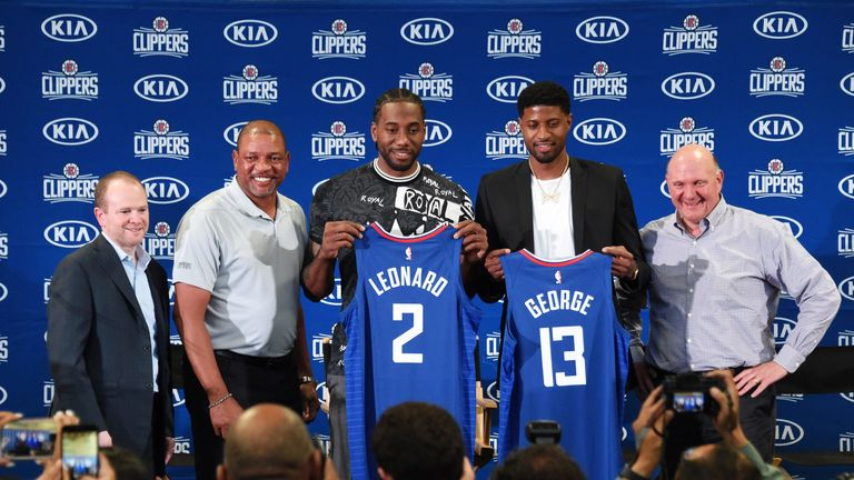 Lawrence Frank, Doc Rivers and Steve Ballmer welcome Kawhi Leonard and Paul George to the Los Angeles Clippers