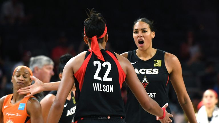 Liz Cambage and A'ja Wilson celebrate an Aces win