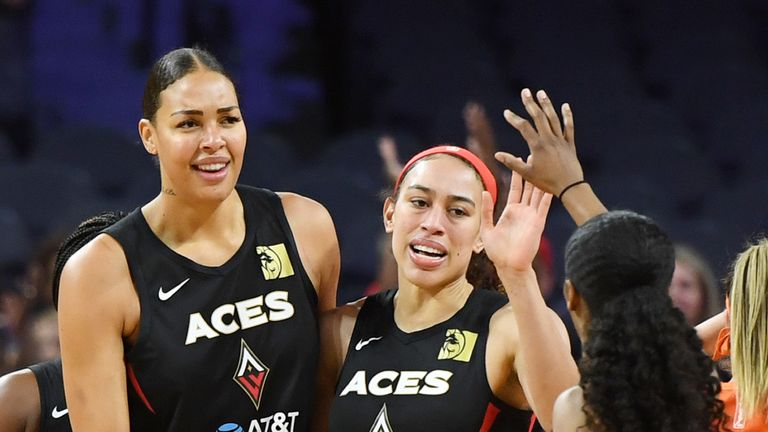 Liz Cambage, Dearica Hamby and Sydney Colson of the Las Vegas Aces celebrate on the court