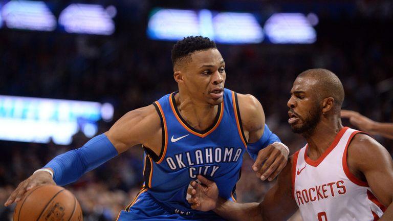 Russell Westbrook back down Chris Paul in a Thunder-Rockets regular season game