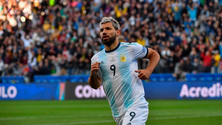Sergio Aguero wheels away after slotting Argentina's opener against Chile